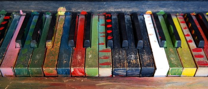 Multi-colored piano keys in need of cleaning