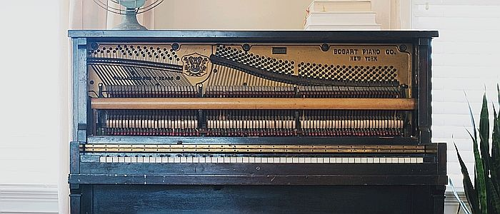 Opened piano for cleaning interior