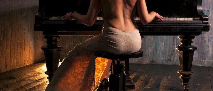 Woman seated at piano