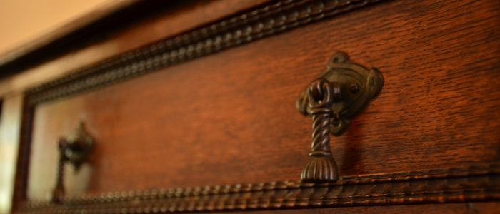 Antique furniture moved from storage and refinished